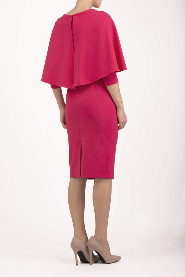 model wearing diva catwalk lizanne pencil-skirt dress with an attached wide cape detail and 3 4 sleeves in colour honeysuckle pink back
