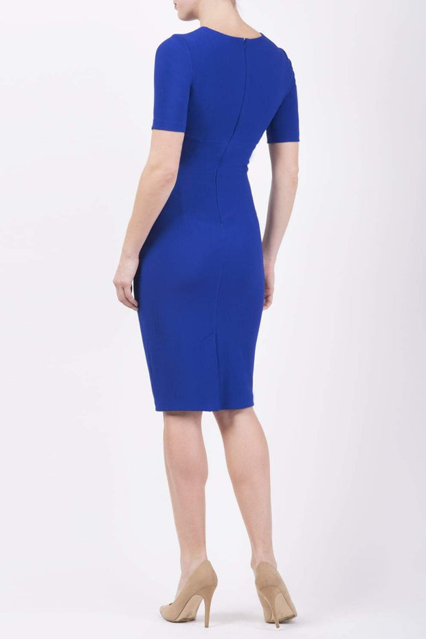 model is wearing diva catwalk lydia short sleeve pencil fitted dress in royal blue colour with rounded neckline with a slit in the middle back