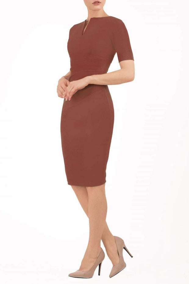 model is wearing diva catwalk lydia short sleeve pencil fitted dress in brown colour with rounded neckline with a slit in the middle back