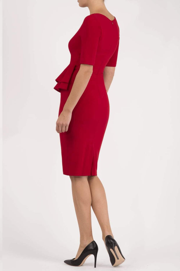 Model wearing the Diva Lynette dress in pencil dress design in scarlet red back image