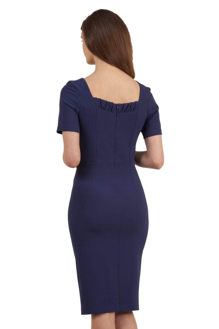 model wearing diva catwalk mitzi short sleeve pencil dress with square frilled neckline in navy blue back