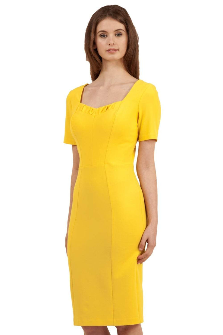 model wearing diva catwalk mitzi short sleeve pencil dress with square frilled neckline in freesia yellow front