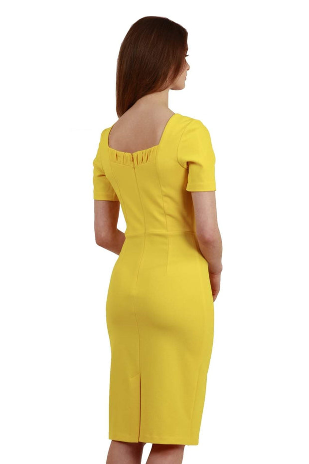 model wearing diva catwalk mitzi short sleeve pencil dress with square frilled neckline in freesia yellow back