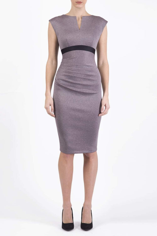 blonde model is wearing dive catwalk nadia sleeveless contrast band pencil-skirt dress with rounded neckline with a slit in the middle in pink front