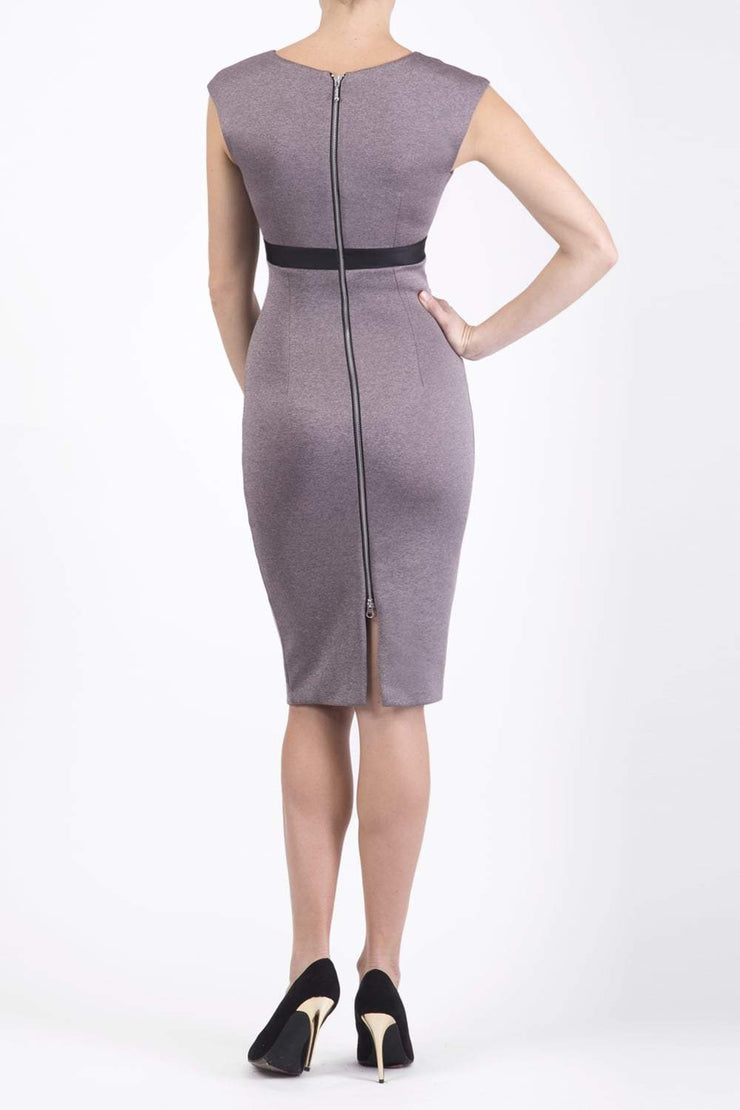 blonde model is wearing dive catwalk nadia sleeveless contrast band pencil-skirt dress with rounded neckline with a slit in the middle in pink back