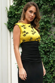 brunette model wearing diva catwalk  dresses from england nadia colour block in black and gold colours sleeveless dress front