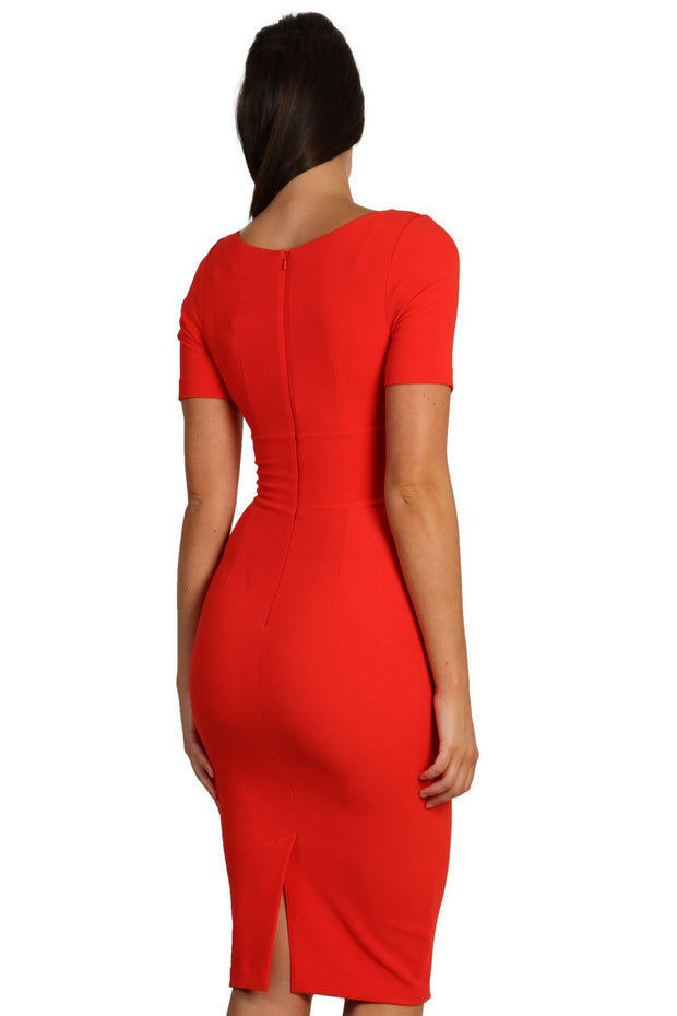 Model wearing the Diva Opal dress in pencil dress design in fiesta orange back image