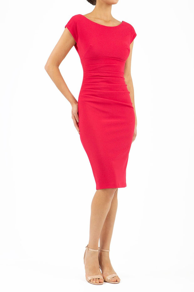Model wearing Diva Catwalk Polly Rounded Neckline Pencil Cap Sleeve Dress with pleating across the tummy area in Raspberry Pink front