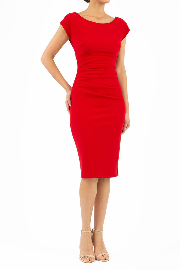 Model wearing Diva Catwalk Polly Rounded Neckline Pencil Cap Sleeve Dress with pleating across the tummy area in True Red front