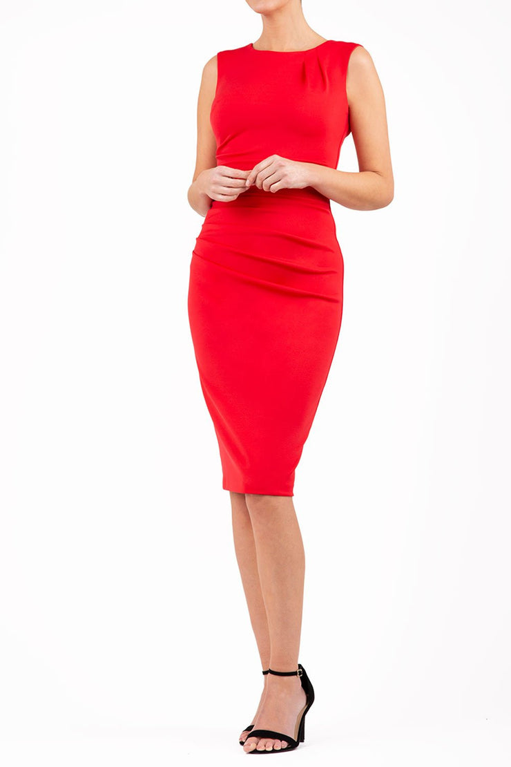 model wearing diva catwalk primula pencil skirt dress in pink with pleating on one side and sleeveless design in colour red front