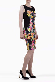 Model wearing the Diva Rita Floral Print dress in pencil dress design in wild garden black front image