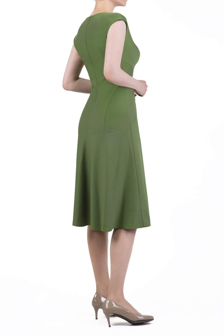 model wearing diva catwalk rochelle swing skirt a line dress without sleeves with a low v neck in apple green side