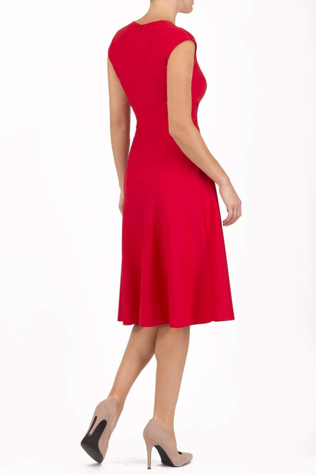 model wearing diva catwalk rochelle swing skirt a line dress without sleeves with a low v neck in red back