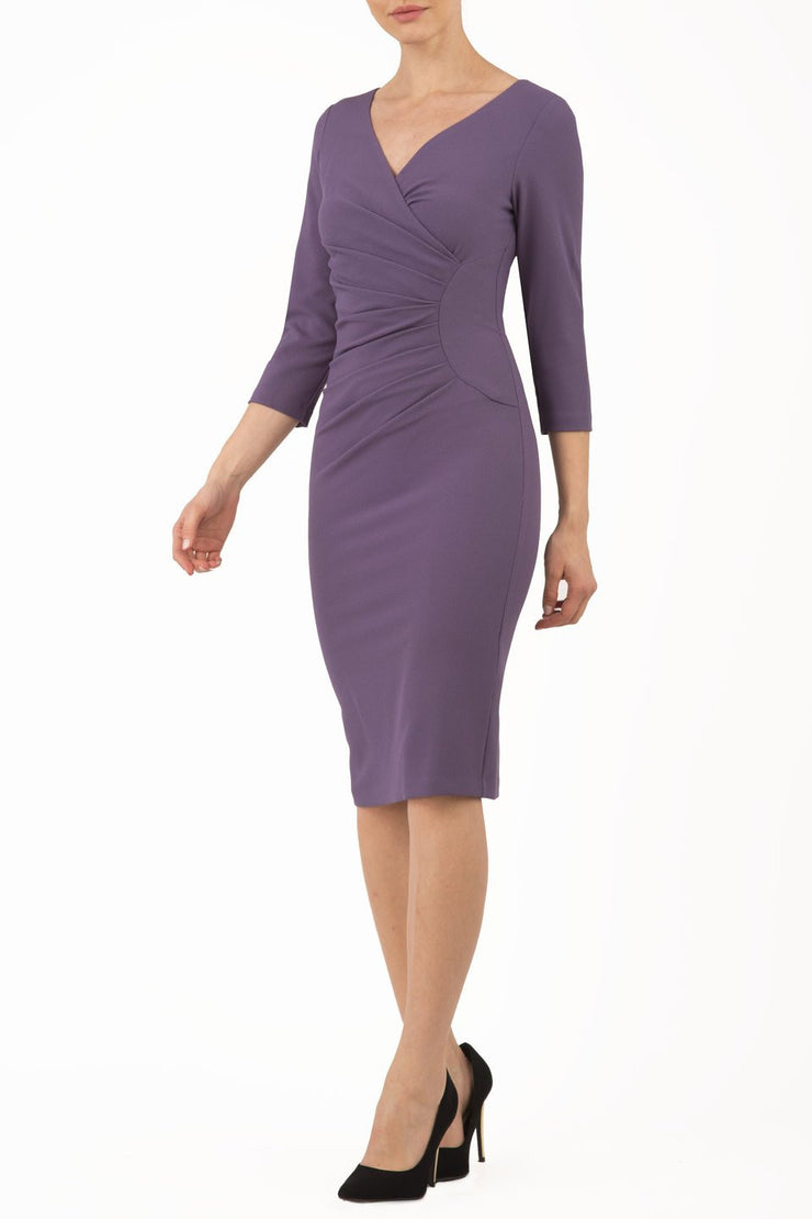 Model wearing the Diva Chelsea Pencil dress with V neckline and three-quarter sleeves in dark mauve front image
