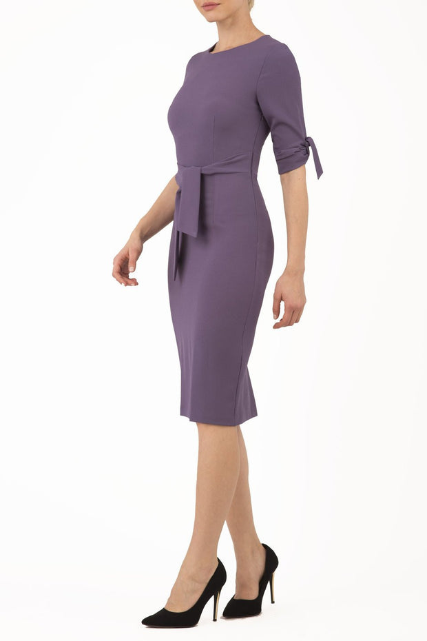 Model wearing the Diva Tryst dress in pencil dress design in dark mauve front image