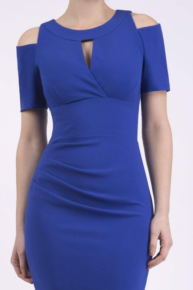 model wearing diva catwalk ruth pencil skirt dress with a keyhole cut in rounded neckline and cold shoulder detail in royal blue colour front