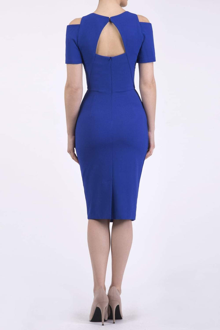 model wearing diva catwalk ruth pencil skirt dress with a keyhole cut in rounded neckline and cold shoulder detail in royal blue colour back
