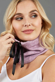 blonde model is wearing diva catwalk rappa soft neck warmer in pink front