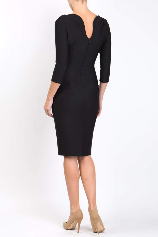 Model wearing the Seed Agatha in pencil dress design in black back image