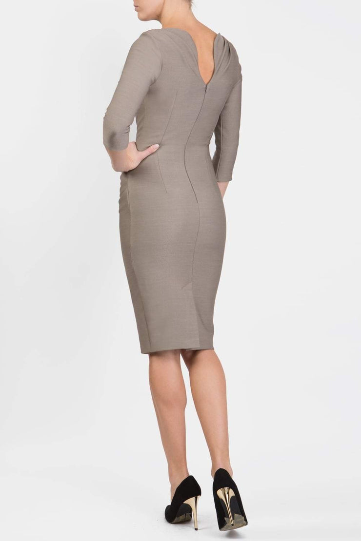 Model wearing the Seed Agatha in pencil dress design in taupe brown back image