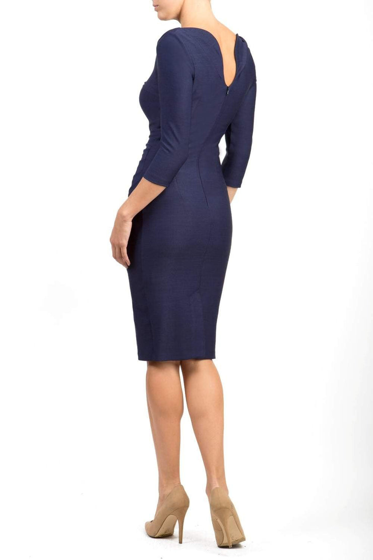 Model wearing the Seed Agatha in pencil dress design in navy blue back image