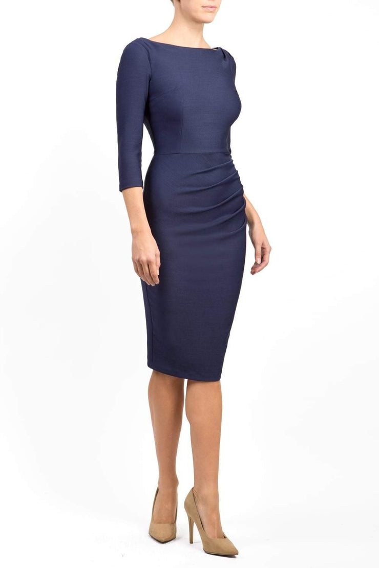 Model wearing the Seed Agatha in pencil dress design in navy blue front image