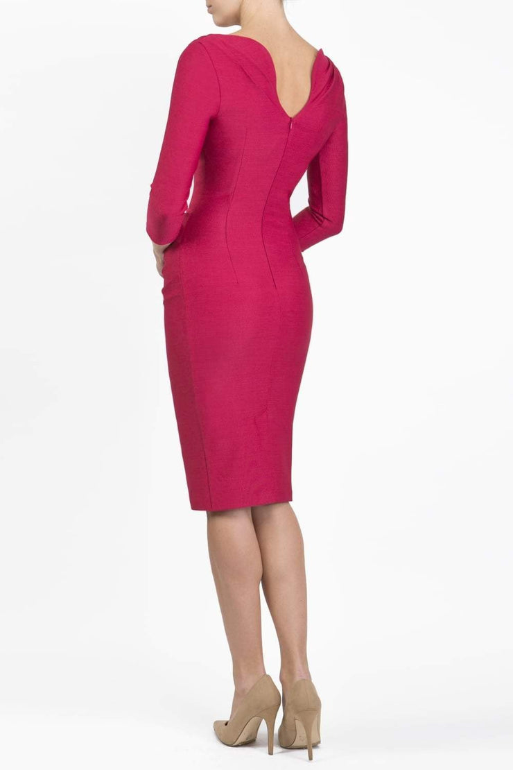Model wearing the Seed Agatha in pencil dress design in crimson pink back image