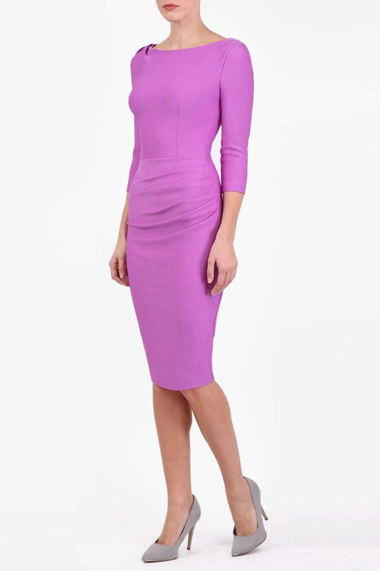 Model wearing the Seed Agatha in pencil dress design in magenta mist front image