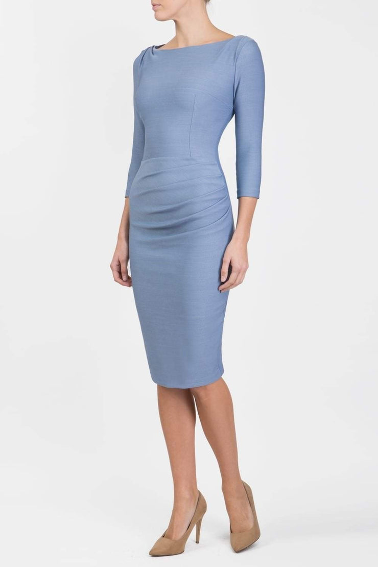 Model wearing the Seed Agatha in pencil dress design in steel blue front image