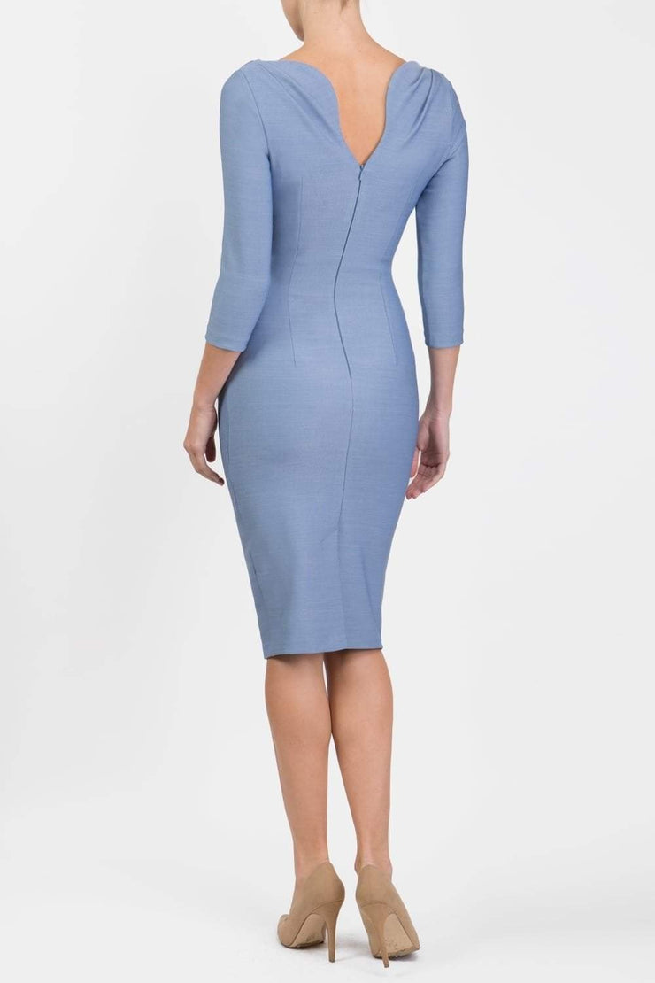 Model wearing the Seed Agatha in pencil dress design in steel blue back image