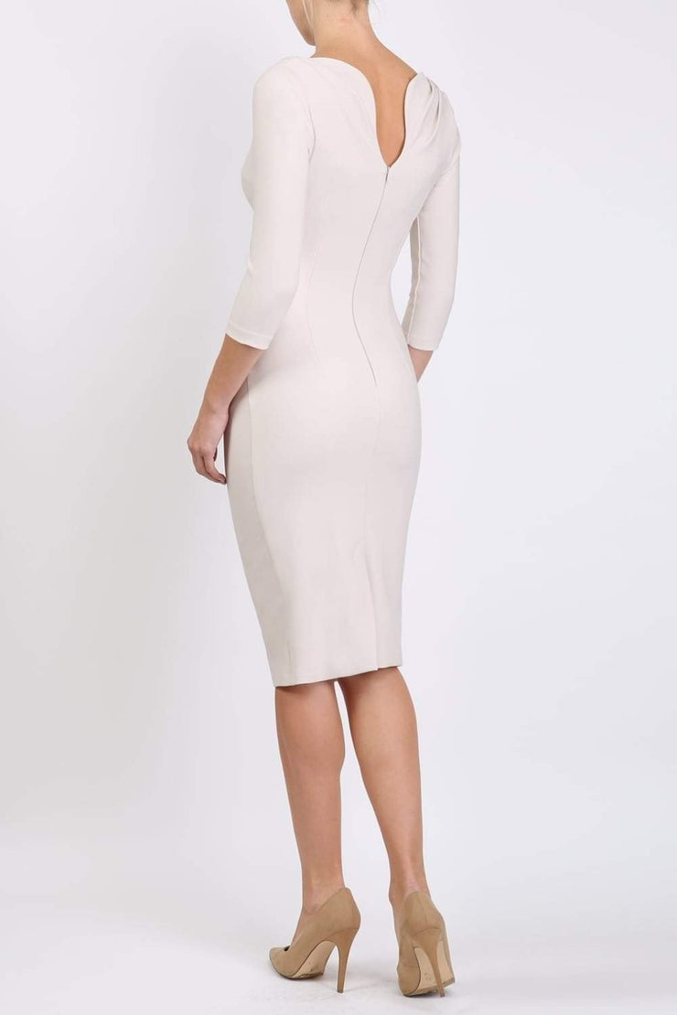 Model wearing the Seed Agatha in pencil dress design in sandy cream back image