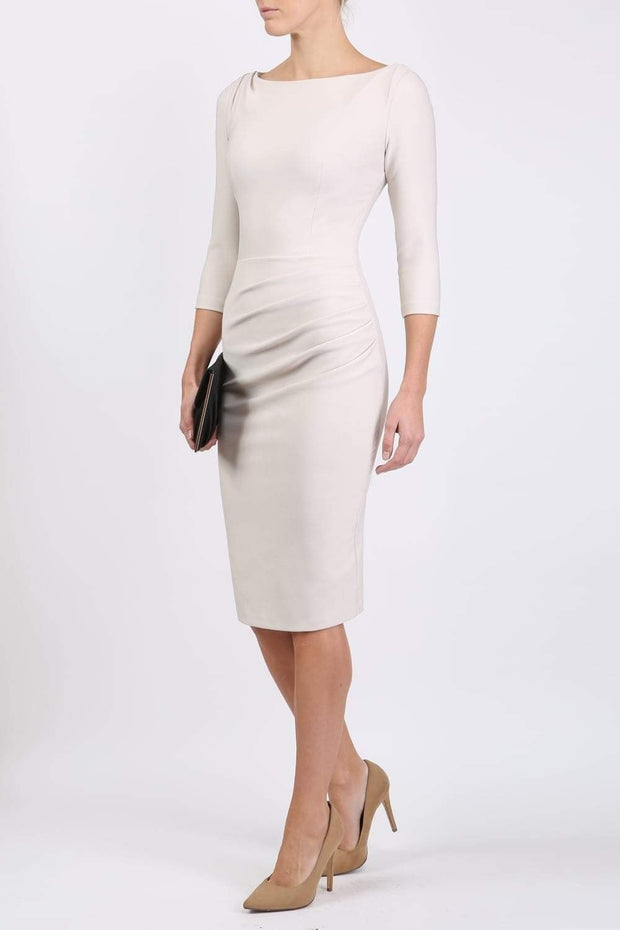 Model wearing the Seed Agatha in pencil dress design in sandy cream front image