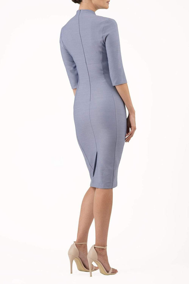 Model wearing the Seed Amalfi in pencil dress design in steel blue back image