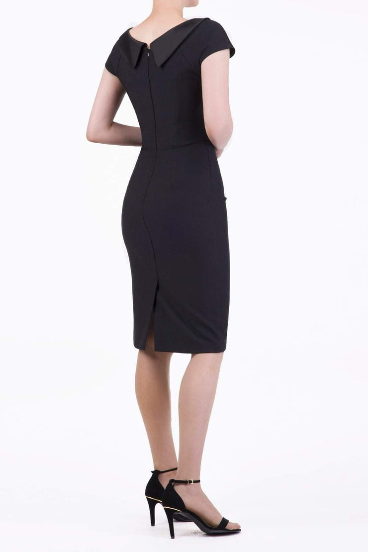 model wearing diva catwalk little black dresses with low v-nwcklinw and pencil skirt sleeveless style back