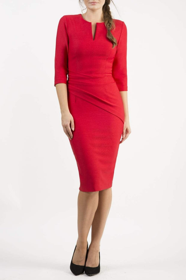 brunette model wearing seed diva catwalk milton sleeved pencil dress with a rounded neckline with a split in the middle in salsa red front