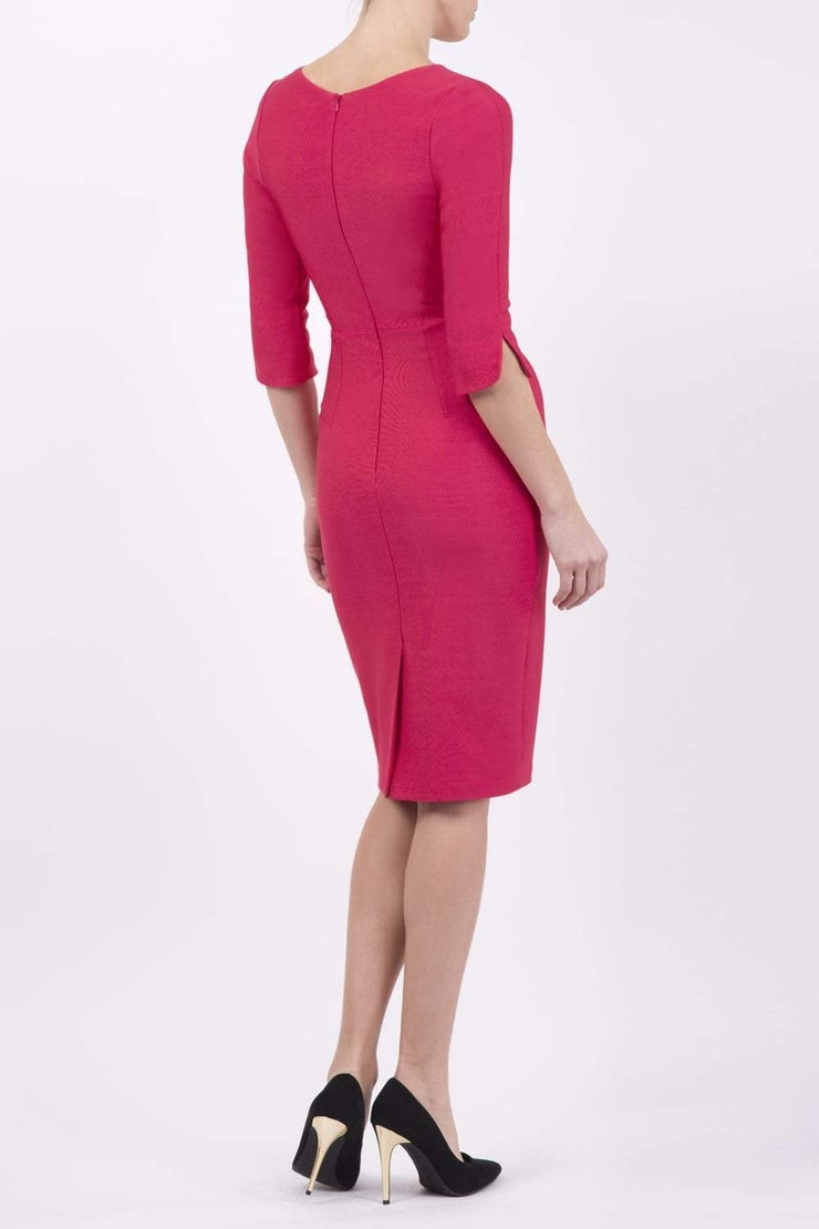 model wearing seed couture zara pencil skirt dress in pink with asymmetric neckline with sleeves back