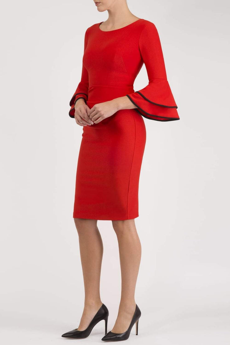 blonde model wearing diva catwalk tina pencil skirt dress with rounded neckline and flute sleeve in electric red front