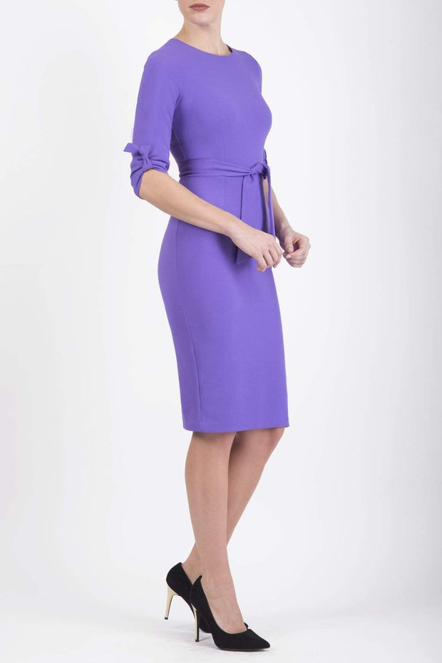 Model wearing the Diva Tryst dress in pencil dress design in opulent violet front image