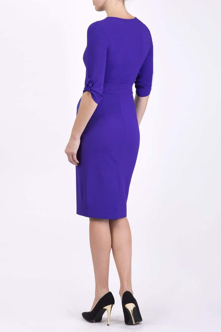 Model wearing the Diva Tryst dress in pencil dress design in spectrum indigo back image