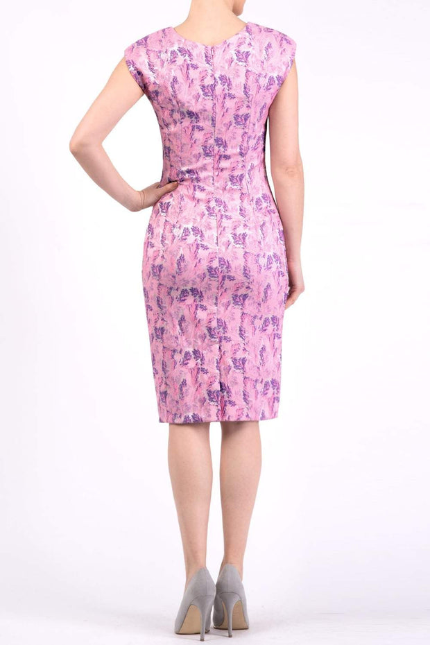 Model wearing the Diva Vera Floral dress in pencil dress design in pink lavender back image