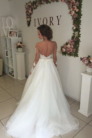 open-back-long-sleeves-wedding-dress-with-transparent-neckline-1