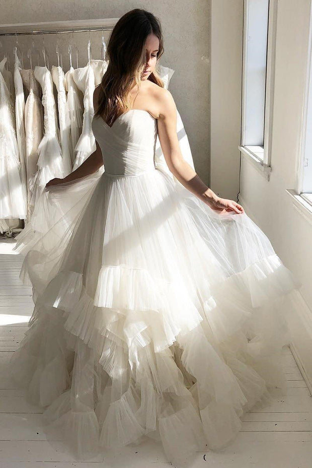 pleated-sweetheart-ivory-wedding-gown-with-ruffle-tulle-skirt
