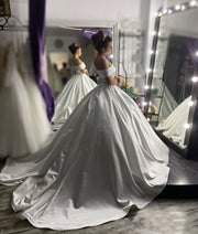 structured-satin-ball-gown-wedding-dress-with-off-the-shoulder-sleeves-1