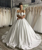 structured-satin-ball-gown-wedding-dress-with-off-the-shoulder-sleeves-3