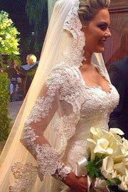 vintage-lace-wedding-dress-with-sheer-long-sleeves-1