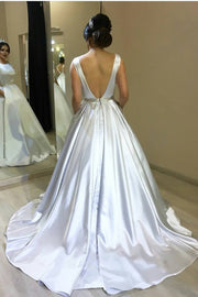 white-satin-wedding-gown-style-with-modern-pockets-1