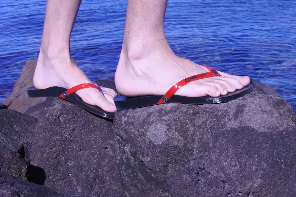 Retraction Footwear COVID-19 Thongs on rocks