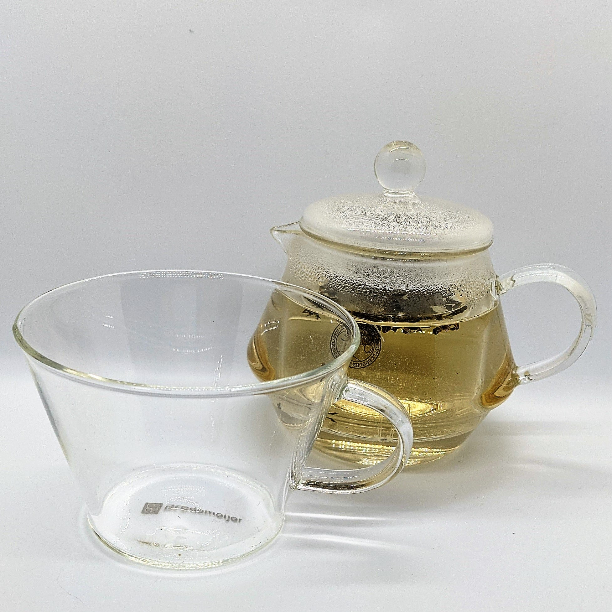 steeped tea in a glass tea for one set