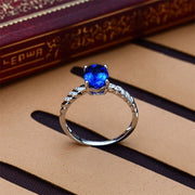 1 Carat Sapphire and Moissanite Diamond Halo Engagement Ring in White Gold