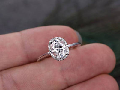 Oval cut Moissanite and Diamond Halo Engagement Ring